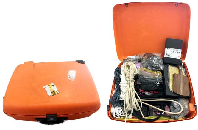 Bright orange suitcase, shown closed, and open full of toys